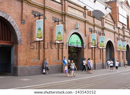 PADDY�s MARKET, SYDNEY -�� JANUARY 9: Pedestrians walk past Sydney'��s Paddy's Market on January 9, 2011. The market, centrally located in Sydney CBD, is a major destination for weekend shoppers - stock photo