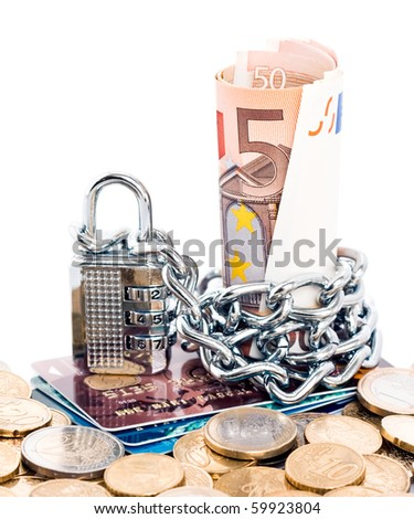 Padlock and chain around Euro currency on a stack of plastic credit cards and euro coins isolated against a white background. - stock photo