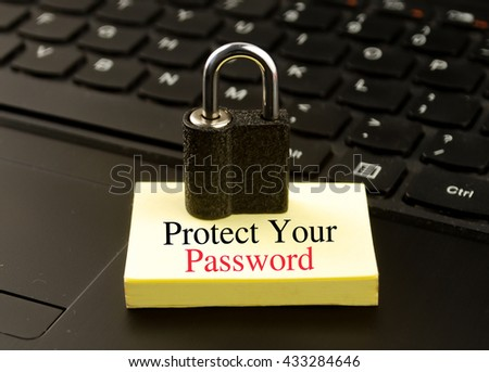 Padlock and note with word protect your password - stock photo