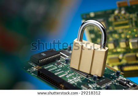 padlock and printed circuit board, network security concept