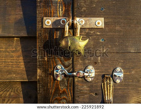 Padlock on a wooden door  - stock photo