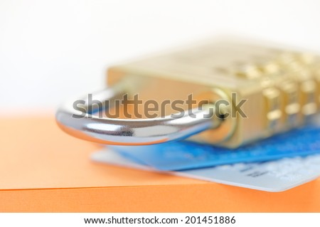 Padlock on credit cards. Card security concept with shallow dof. - stock photo