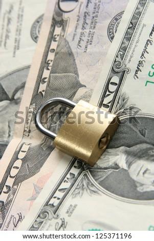 Padlock on dollars background - stock photo
