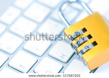 Padlock on keyboard - stock photo