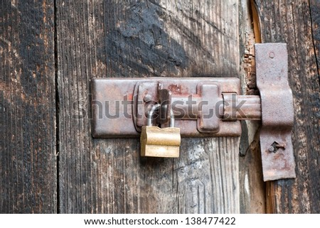 padlock on old barn - stock photo