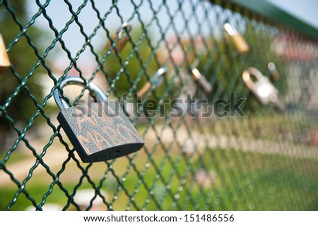 padlock on the bridge as the symbol of love and faithfulness.