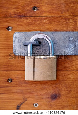 Padlock on wooden door. Close-up.