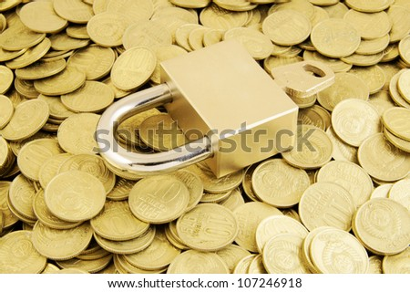 stock-photo-padlock-with-key-on-coins-ba