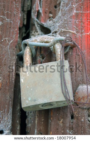 padlock with spider's web