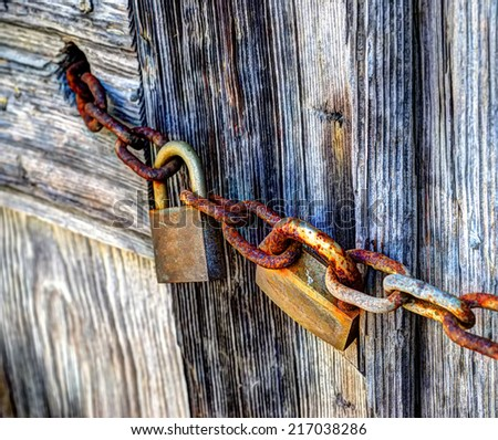 padlocks and rusty chain in hdr tone - stock photo