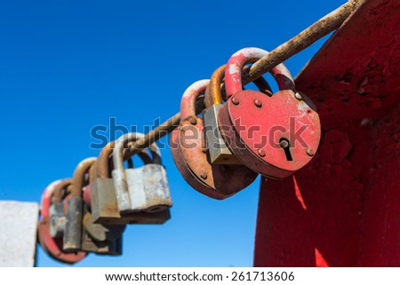 Padlocks for love. Closed red padlock with heart - stock photo