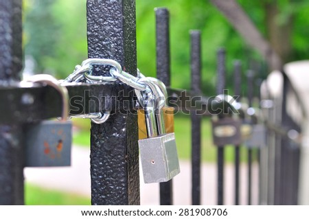 Padlocks, locked to railings on a small bridge - stock photo