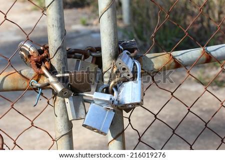 Padlocks on gate - stock photo