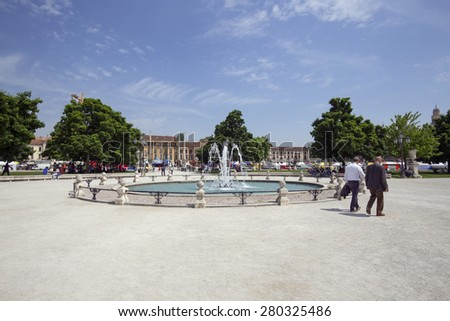 PADUA, ITALY - MAY 5, 2015: Tourists visit the Prato della Valle, which dates from the 10th century.