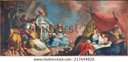 PADUA, ITALY - SEPTEMBER 8, 2014: Paint of stcene - Moses and the Israelites Gathering of Manna from 16th century by unknown painter  in Cathedral of Santa Maria Assunta (Duomo) and the Eucharist chapel. - stock photo