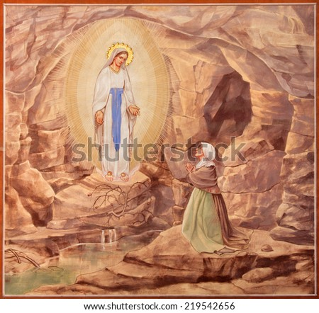 PADUA, ITALY - SEPTEMBER 9, 2014: The Painting of the Apparitioin of Virgin Mary in Lourdes in church Basilica del Carmine from 1933 by Antonio Sebastiano Fasal.  - stock photo