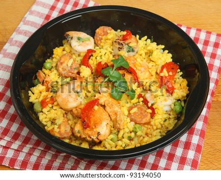 Paella ready meal with shrimp, chicken and chorizo. - stock photo