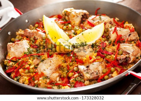 paella with rabbit in a pan - stock photo