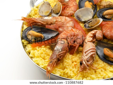 Paella with seafood typical of Spain - stock photo
