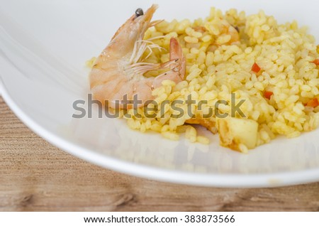 Paella with seafood, typical Spanish dish on white background. - stock photo