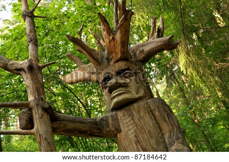 Pagan wooden idol in a woods. - stock photo