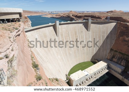 Page, AZ, USA - July 09, 2016: Glen Canyon Dam Wall and Carl Hayden Visitor Center  near the Page town. The dam provide hydroelectricity and flow regulation from the Colorado River Basin.