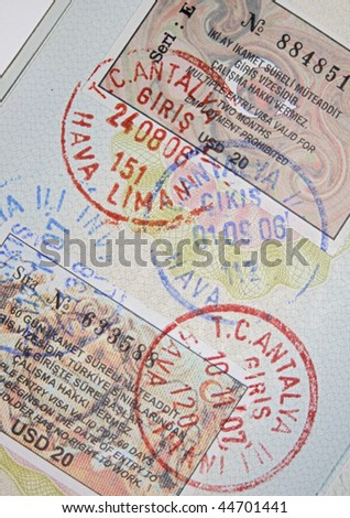 Page of passport with turkish visas and stamps - stock photo