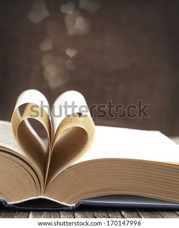 Pages of a book curved into a heart shape - stock photo