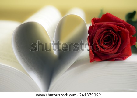 Pages of a book curved into a heart shape and red roses. Valentines day card.  - stock photo