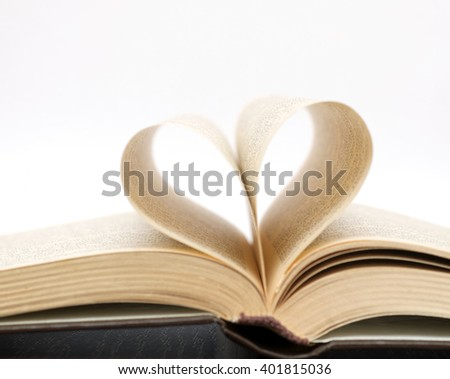 pages of a book in the form of heart - stock photo