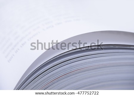 Pages of an open book with with shallow depth of field on white background