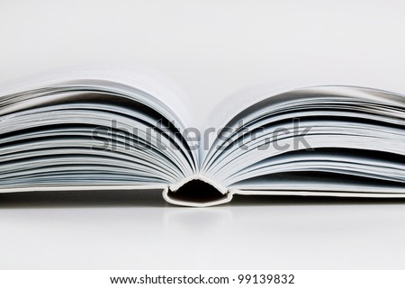 Pages open a thick book on white background - stock photo