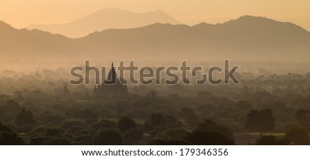 Pagodas in Bagan during sunrise - stock photo