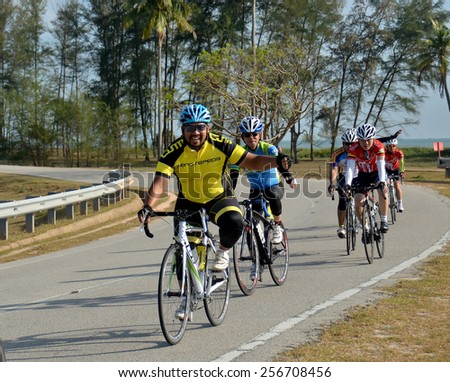 PAHANG, MALAYSIA-FEB 28: An unidentified group of cyclists in action at the final stage of UMP RIDE Challenge  on February 28, 2015 in Pahang. 280 cyclists took part in this open event.