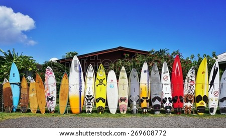 PAIA, HI -30 MARCH 2015- Editorial: Colorful surfboards are lined up in the streets of Maui. Hawaii is the birthplace of modern surfing and home to the world's major big wave surfing competitions. - stock photo