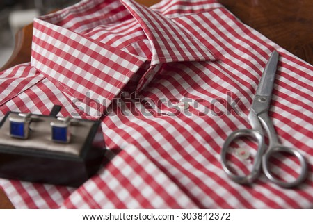 paid shirt with cuff links and scissors close up - stock photo
