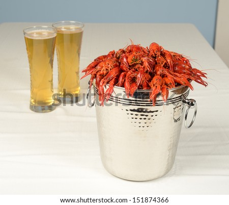 pail full of river lobster served with beer - stock photo