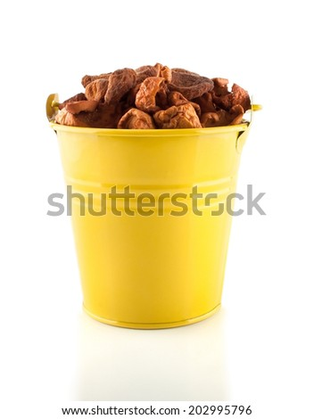 Pail with dried apples and apricots - stock photo