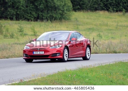 PAIMIO, FINLAND - JULY 31, 2016: Tesla Model S luxury sedan with the new look on rural road in South of Finland. Tesla updates also the exterior of the Model S in April 2016.