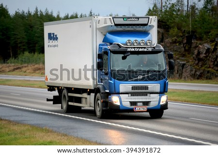 PAIMIO, FINLAND - NOVEMBER 6, 2015: Blue Volvo FE refrigerated transport truck on motorway. Volvo FE is a multi-purpose vehicle for city and regional transport. - stock photo