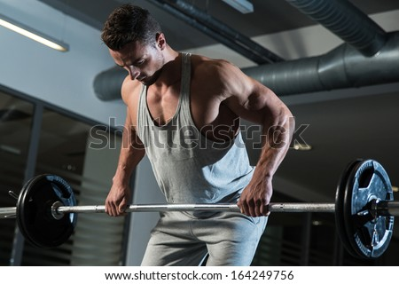 Pain and Gain. Man Doing Heavy Weight Exercise For Back - stock photo