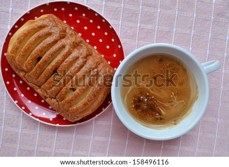 Pain au Chocolat and cup of coffee - stock photo