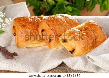 Pain au chocolat on wooden table  - stock photo