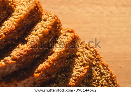 Pain d epices or French Honey Bread. Original Homemade Fresh Baked. Country, Still Life. Close up, Selective. Wood Background. - stock photo