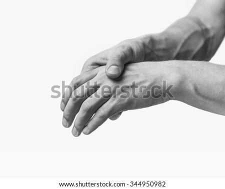 Pain in a male hand. Man holds his hand. Monochrome image, isolated on a white background