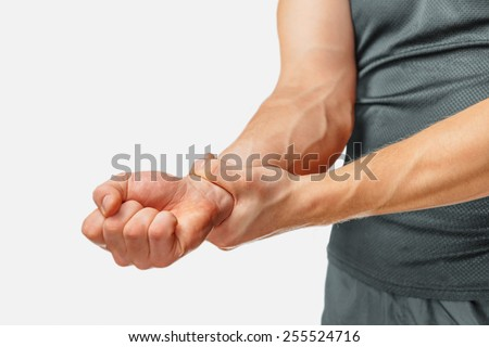 Pain in a male wrist, close-up image - stock photo