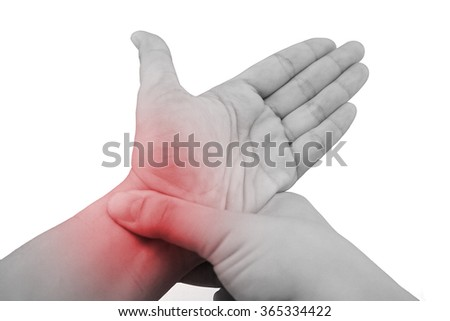 Pain in a wrist. holding hand to spot of wrist pain. - stock photo