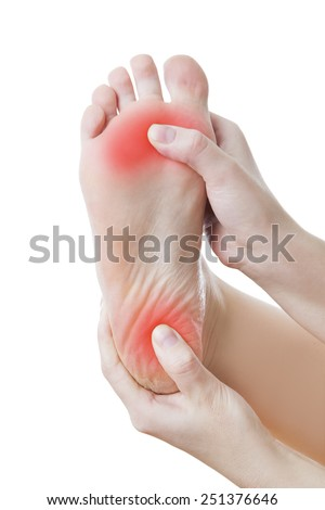 Pain in the foot. Massage of female feet. Pedicures.  Isolated on white background. - stock photo