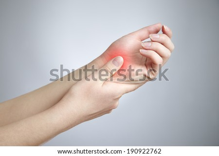 Pain in the joints of the hands. Care of female hands. - stock photo