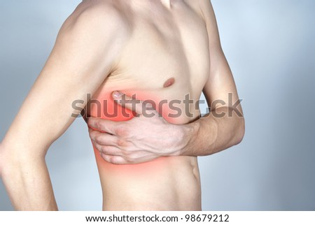 pain in the side marked with a red - stock photo